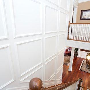 Foto de escalera en U, tradicional, grande, con escalones de madera y contrahuellas de madera
