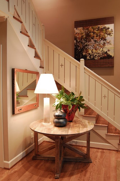 Rustic Staircase by Studio C Architecture & Interiors