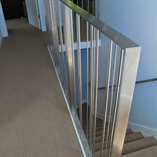 Modern Staircase by Cardea Building Co.