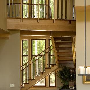 Staircase - contemporary wooden staircase idea in Atlanta