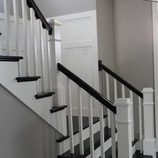 Farmhouse Staircase by Southern Comfort Homes of Louisville