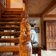 Rustic Staircase by Woodhouse Post & Beam Homes