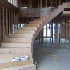 Traditional Staircase by NDK Construction, Inc.