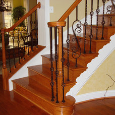 Traditional Staircase by Lighted Landings