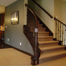 Traditional Staircase by Construction Finishes LLC