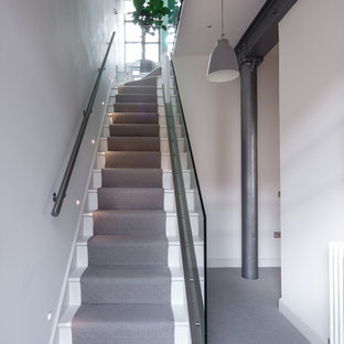 Photo of an urban painted wood straight staircase in London with painted wood risers.