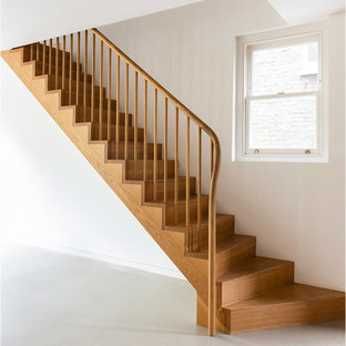 Inspiration for a medium sized contemporary wood straight wood railing staircase in London with wood risers.