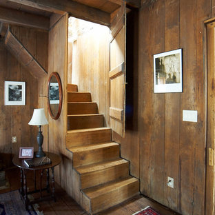 Inspiration for a rustic wood staircase in Charlotte with wood risers.