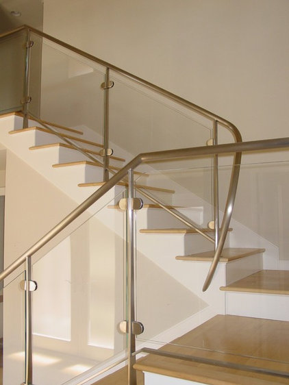 Contemporary Staircase by BeautifulRemodel.com