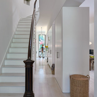 Staircase - mid-sized transitional wooden curved wood railing staircase idea in New York