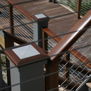 Inspiration for a mid-sized wooden u-shaped staircase remodel in Orange County with painted risers