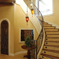 Mediterranean Staircase by Stadler Custom Homes