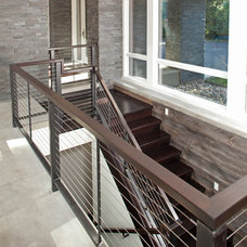 Contemporary Staircase by John Kraemer & Sons