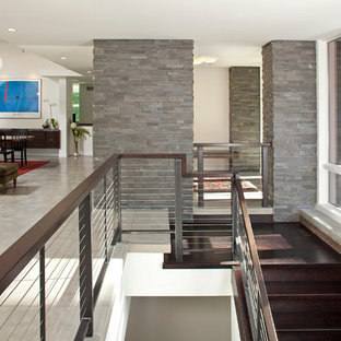 Example of a trendy cable railing staircase design in Minneapolis