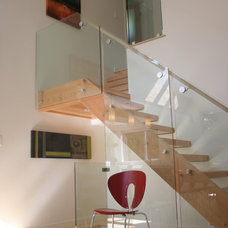Contemporary Staircase by Portal Design Inc