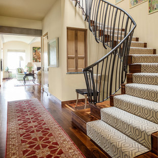 Staircase - mediterranean wooden staircase idea in Dallas with wooden risers