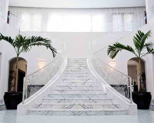Elegant Example Of A Trendy Marble L Shaped Glass Railing Staircase Design In Denver