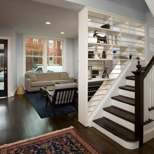 Example of a small transitional wooden l-shaped staircase design in DC Metro with painted risers