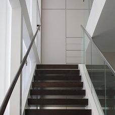 Contemporary Staircase by Doyle McCullar