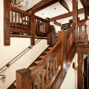 Rustic wood railing staircase in Denver with wood risers.