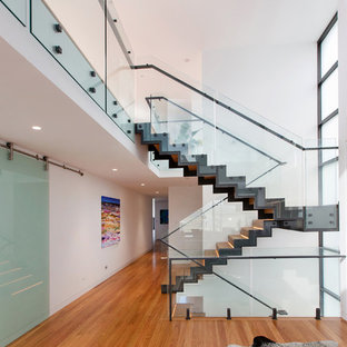 Large contemporary wood u-shaped metal railing staircase in Newcastle - Maitland with wood risers.