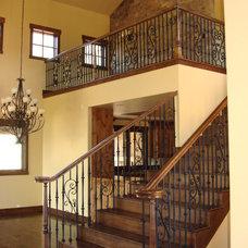 Mediterranean Staircase by DM Neuman Construction Co.