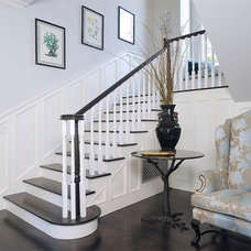 Traditional Staircase by Core Development Group, Inc.