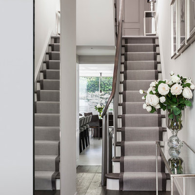 Staircase - small contemporary painted l-shaped staircase idea in London with painted risers