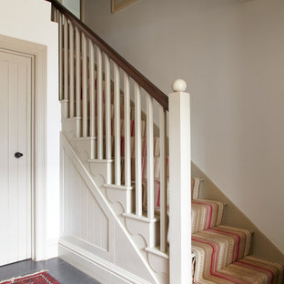 Design ideas for a rural painted wood straight staircase in Wiltshire with painted wood risers.