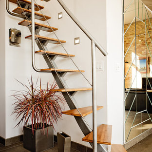 Example of an urban wooden straight open staircase design in Other