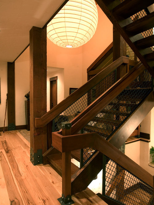 Example Of A Mountain Style Wooden U Shaped Open And Metal Railing Staircase  Design In