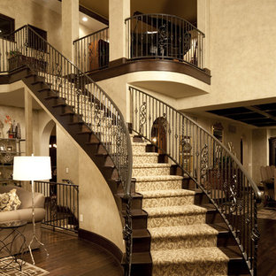 Inspiration for a timeless wooden curved staircase remodel in Indianapolis with wooden risers