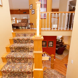 Mid-sized transitional painted u-shaped staircase photo in Boise with wooden risers