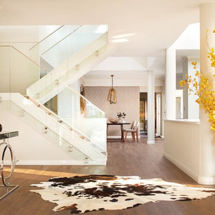 Staircase - large contemporary wooden l-shaped staircase idea in Perth with glass risers