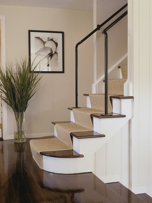 example of a trendy wooden staircase design in new york