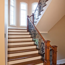Traditional Staircase by Walker Homes LTD