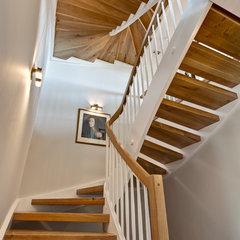 eclectic staircase by Feil Inc. Wood Flooring