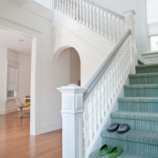Inspiration for a traditional carpeted staircase in San Francisco with carpeted risers.