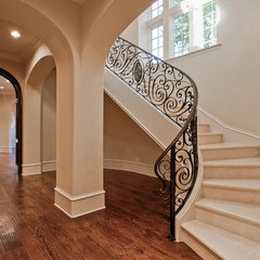 mediterranean staircase by Calais Custom Homes