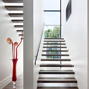 Contemporary wood u-shaped staircase in Melbourne with open risers.