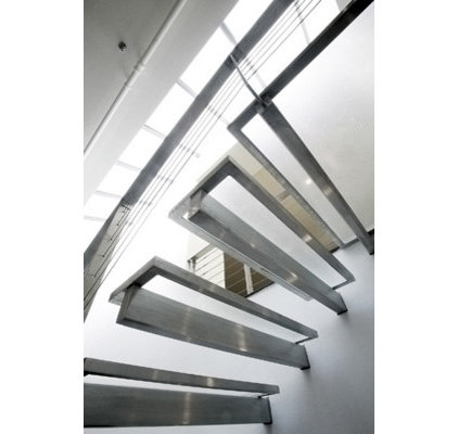 modern staircase by Eisner Design LLC