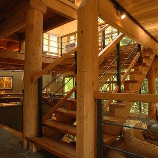 Foto de escalera recta, actual, de tamaño medio, sin contrahuella, con escalones de madera y barandilla de varios materiales