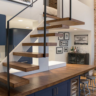 Staircase - mid-sized modern wooden floating metal railing staircase idea in New York