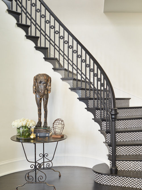 Example Of A Classic Wooden Curved Wood Railing Staircase Design In Seattle
