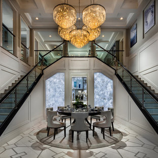 Inspiration for a huge transitional carpeted l-shaped glass railing staircase remodel in San Diego with carpeted risers