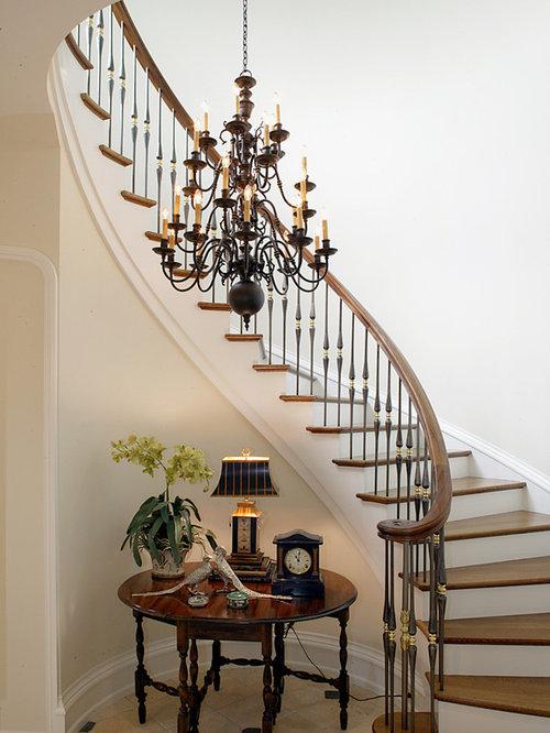 elegant wooden curved metal railing staircase photo in salt