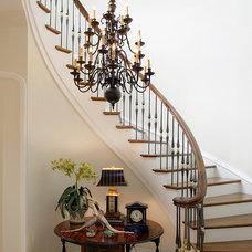 Traditional Staircase by Dewson Construction Company