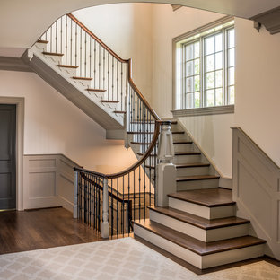 Staircase - large traditional wooden u-shaped metal railing staircase idea in Wilmington with painted risers