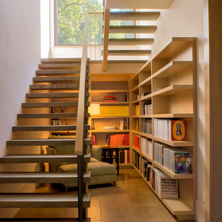 Photo of a country wood u-shaped staircase in San Francisco with open risers.