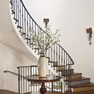 Staircase - huge mediterranean tile curved staircase idea in Los Angeles